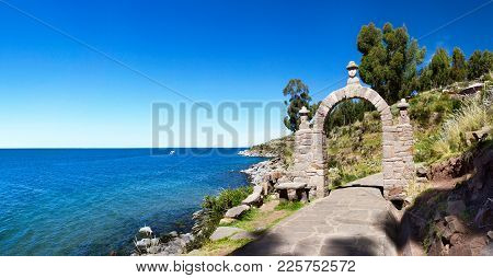 The Entrance Stone Arch Leading To The Interior Of Taquile Island In Lake Titicaca, Peru