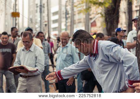 SAO PAULO, BRAZIL - OCOTOBER 17, 2015: Horizontal picture of brazilian christians prayers at Se squa