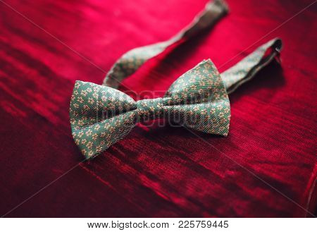 Men's Bow Tie On A Red Background