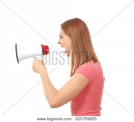 Angry woman using megaphone against white background