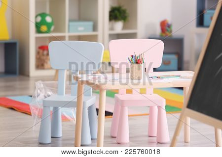 Table with child's drawings at psychologist's office