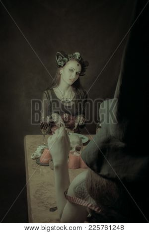 Beautiful Horned Lady Having Dinner Over Dark Background