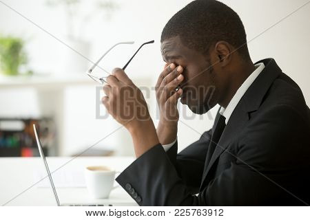 Tired Of Computer African Businessman Taking Off Glasses Feels Eye Strain Fatigue After Long Office