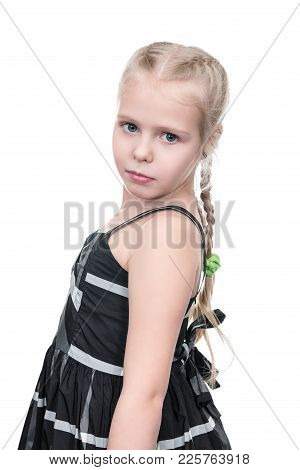 Portrait Of Little Girl In Dress Turned On Camera Isolated On White Background