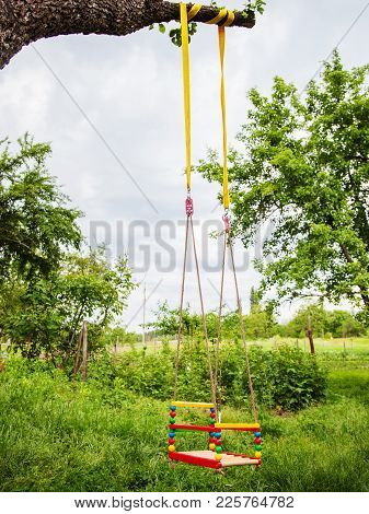 Photo Of An Empty Child Swing Outdoors