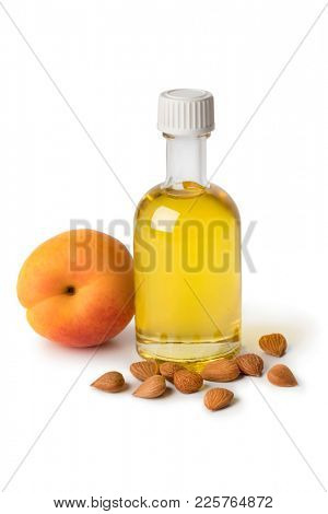Glass bottle with cosmetic apricot kernel oil isolated on white background
