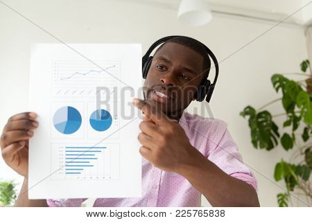 African American Businessman In Headphones Talking By Business Corporate Video Call Showing Infograp