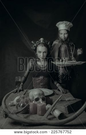 Cook With Main Dish And Her Horned Lord Over Dark Background