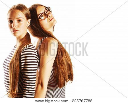 Two Young Workers Isolated On White, Wearing Same Dresses In Strip, Glasses