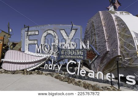 Las Vegas, Nevada - March 10, 2015: These Wedding Chapel, Dry Cleaners And Other Signs Are At The Ne