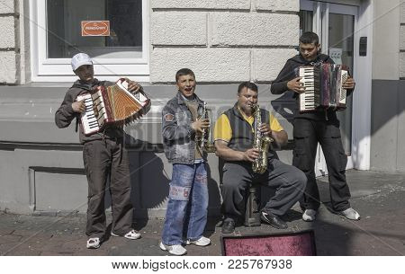 Amsterdam, Netherlands / April 29, 2007: Street Musicians Performing On A Corner In Amsterdam