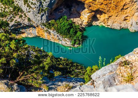 The river Verdon flows along the bottom of the canyon. The water in the river is bright azure. The  midday sun. A fascinating journey through the Provence. Concept of ecological and extreme tourism