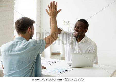 Happy African And Caucasian Businessmen Giving High Five In Office, Diverse Motivated Colleagues Par