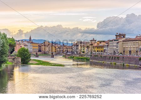 Daylight View To Sunset Above Arno River With Reflections