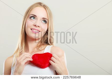 Valentines Day Love Relationships Or Health Care Concept. Blonde Young Woman Holding Red Heart Love