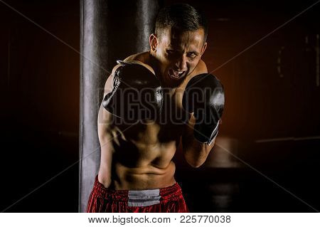 Professional Sportsman Of Mixed Martial Arts Stands In The Fighting Stance And Beats With The Krim O