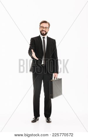 Full-length photo of cheerful businessman in suit attending meeting or job interview with black diplomat in hand isolated over white background