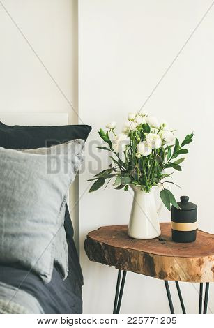 Trendy Scandinavian Style Interior Shot. Bedroom With Washed Linen Grey Pillows And Wooden Nightstan