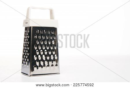 Single Steel Grater Isolated On White Background With Copy Space, Close-up. Grater, Kitchen Accessor