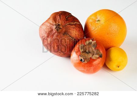 Ripe Fruits Lemon Orange Persimmon Pomegranate Isolated On White Background With Copy Space, Close-u