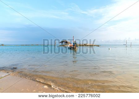 Asian Idyllic Picturesque Coastal Scene With Traditional Long Tail Fishing Boats.