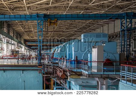 Turbine Generator At The Machinery Room Of Nuclear Power Plant.