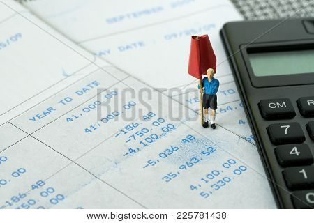 Financial Budget, Debt, Tax Or Set Money Target Concept, Miniature Figure Standing And Holding Red F