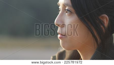 Woman thinking serious