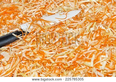 Preparing Homemade Sauerkraut - Fermented Cabbage And Carrots, Rustic Winter Food. Shredded Cabbage,
