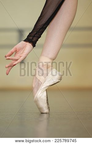 Foot Ballerina In Pointe Shoes. Beautiful Graceful Hand. Rehearsal Dance. Shooting Close-ups