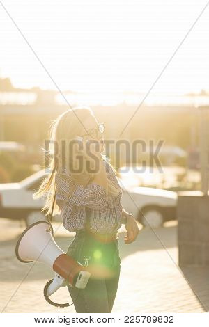 Girl With Loudspeaker And Cellphone