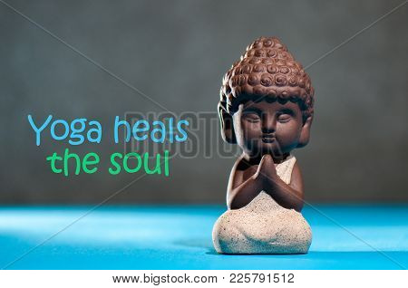 Yoga Heals The Soul - Motivational Inscription On Picture With Baby Buddha.