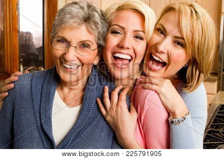 Family Of Three Generation Of Women Smiling.