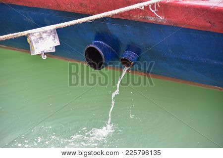 Fishing Boat Releasing Excess Water From It's Ballast.