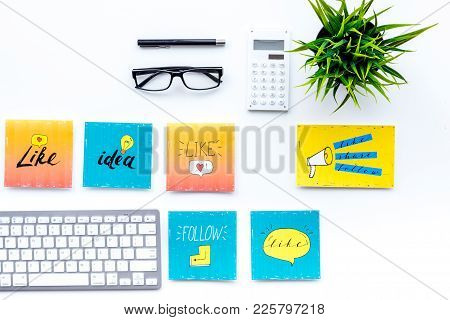 Digital Marketing. Work Desk Of Marketing Specialist With Social Media Icons And Symbols On White Ba