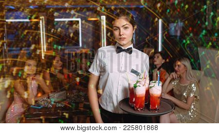 Friends Gathering At Club Party For Fun Entertainment Or Celebration. Nightlife Concept. Waiter Serv