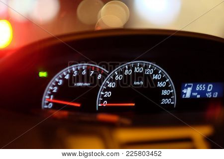 Car Console Dashboard Gages For A Car  Waiting In A Traffic Jam At Evening
