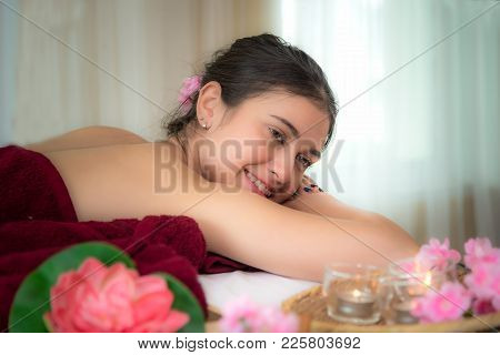 Sap Massage.  Masseur Doing Massage With Treatment Sugar Scrub On Asian Woman Body In The Thai Spa L