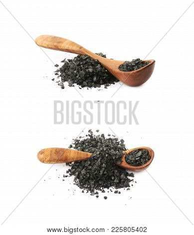 Pile Of Black Salt Crystals With The Wooden Spoon Over It, Composition Isolated Over The White Backg