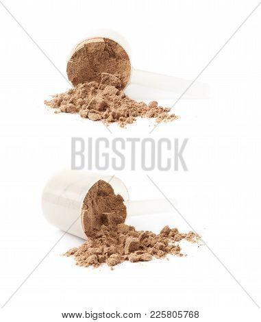 Cocoa Protein Powder In A Plastic Measuring Cup, Composition Isolated Over The White Background , Se