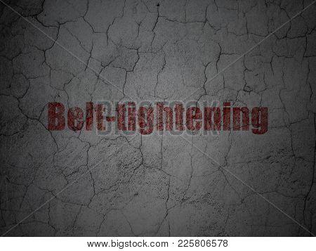 Finance Concept: Red Belt-tightening On Grunge Textured Concrete Wall Background