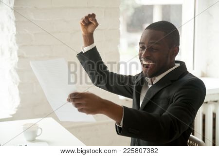 Excited Happy Black Businessman Enjoying Good News About Promotion In Written Notice, African Americ