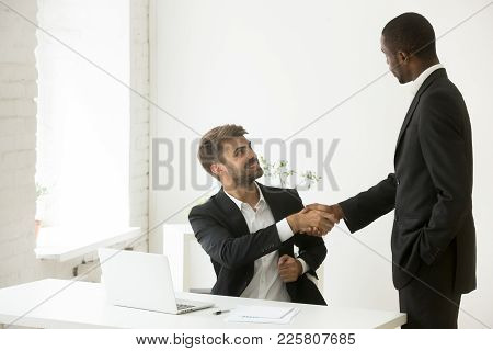 African American Boss Congratulating Caucasian Employee With Promotion Shaking Hands, Black Executiv