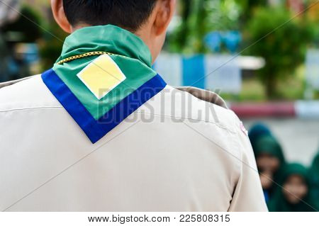 Green,blue And Yellow Frame  Scout Scarf Of Thailand Scoutmaster.and Blurry Muslim Scouts Background