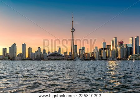 Beautiful Toronto Skyline At Sunset Over Lake, Canada.