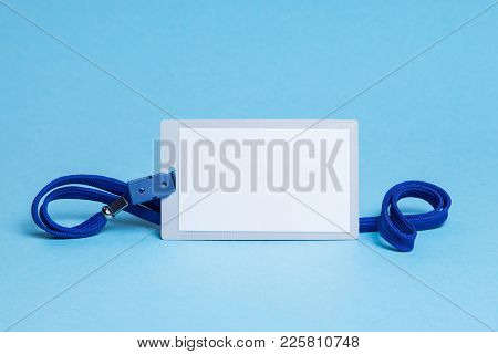 Id Card Badge With Blue Ribbon And On A Blue Background. Mock-up.