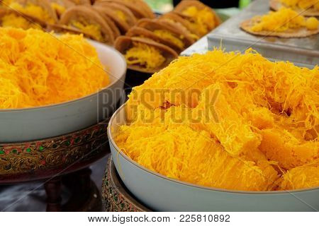 Sweet Egg-serpentine Or Thai Sweetmeat Made Of Egg Yolk Or Gold Threads Dessert In The Big White Bow
