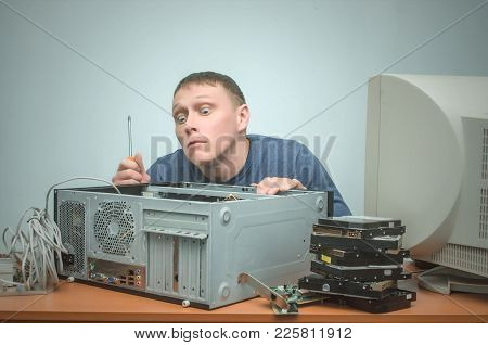 Curious Computer Repairman Looks Inside A Computer In Searching Of Broken Pc Parts. Computer Breakin