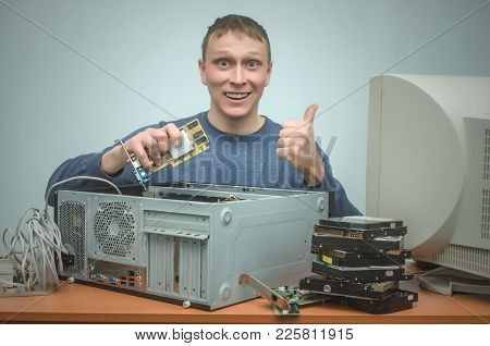 Happy Computer Technician Engineer Is Holding In Hands A New Computer Video Card For Replacement And