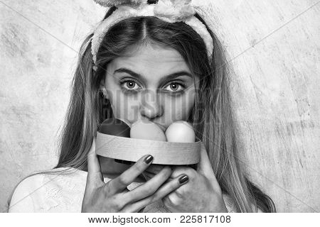 Happy Easter Girl In Pink Bunny Ears With Colorful Painted Eggs In Box, Has Long Blonde Hair And Sur